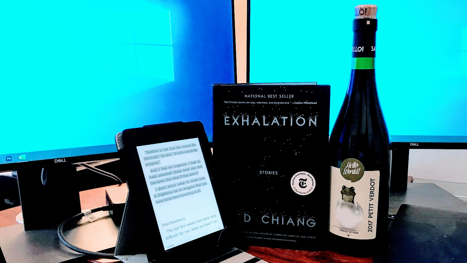 ted chiang exhalation book with wine and computer screens