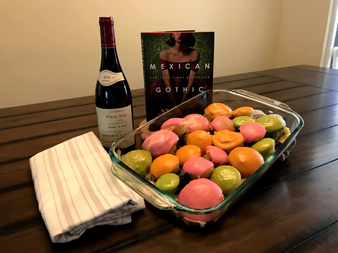 Mexican Gothic novel with wine and cupcakes